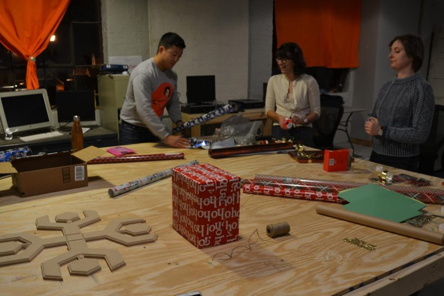 Goodin+%28left%29+participates+in+a+wrapping+paper+themed+event.