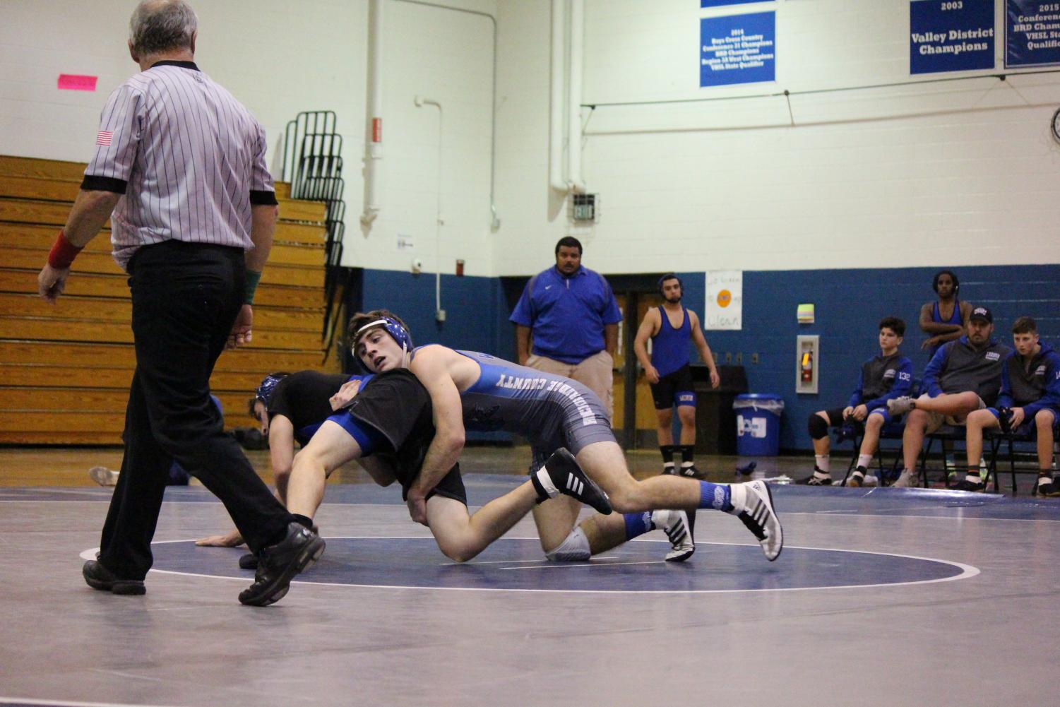 Hinty battling against a Robert E. Lee wrestler at a home match