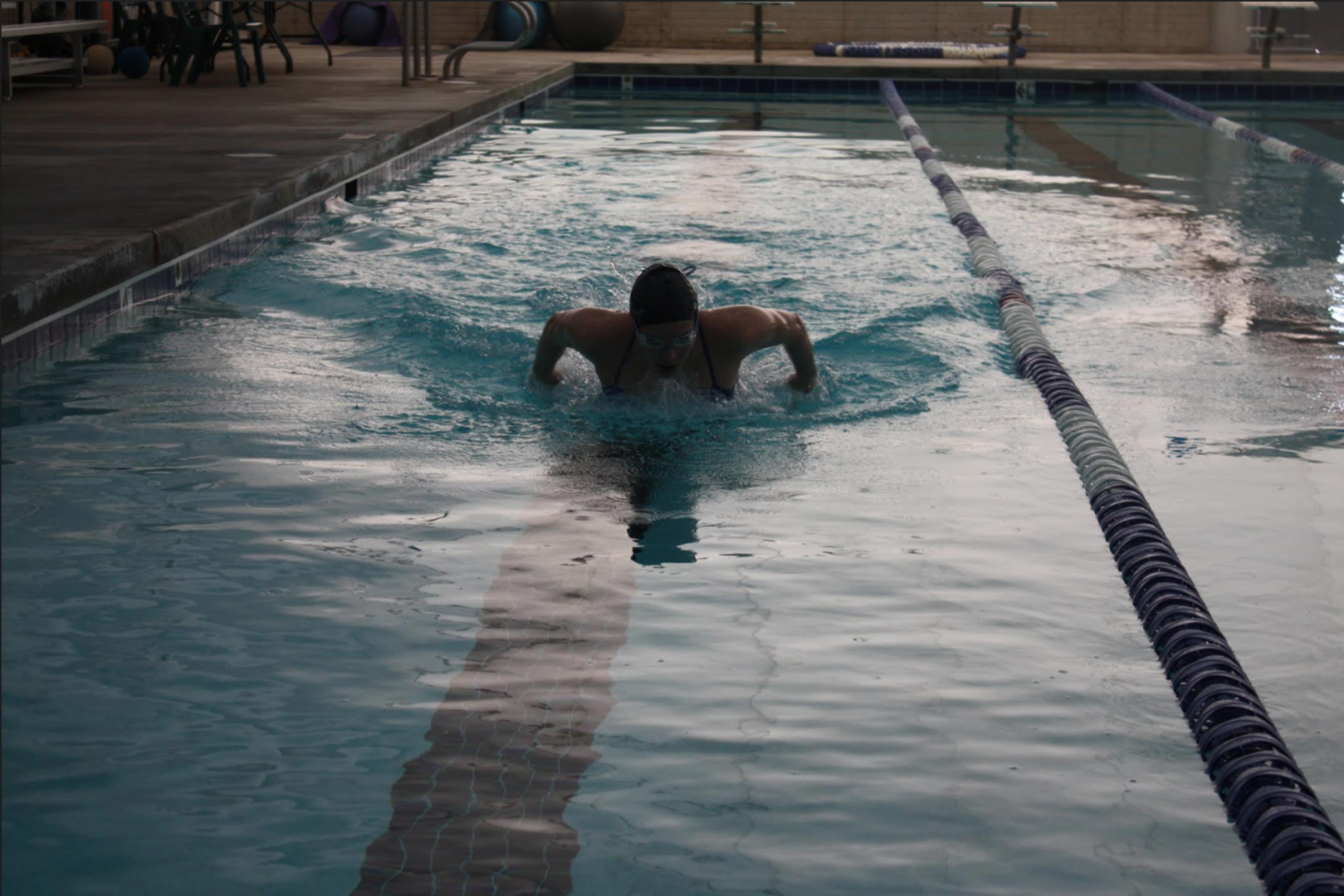Exchange student Petra Cipolla swims butterfly.
