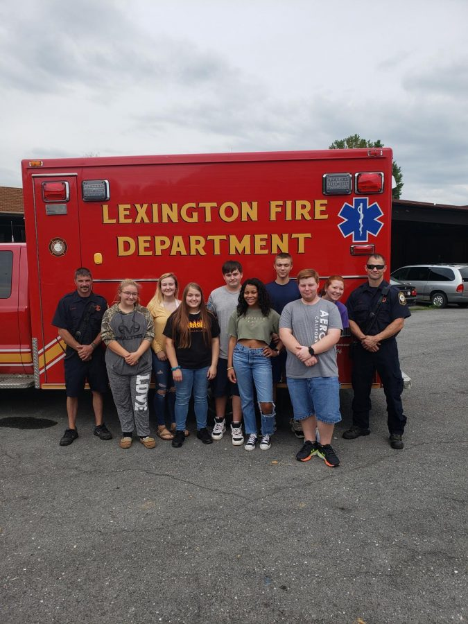 A picture of the EMT class standing outside a ambulance.