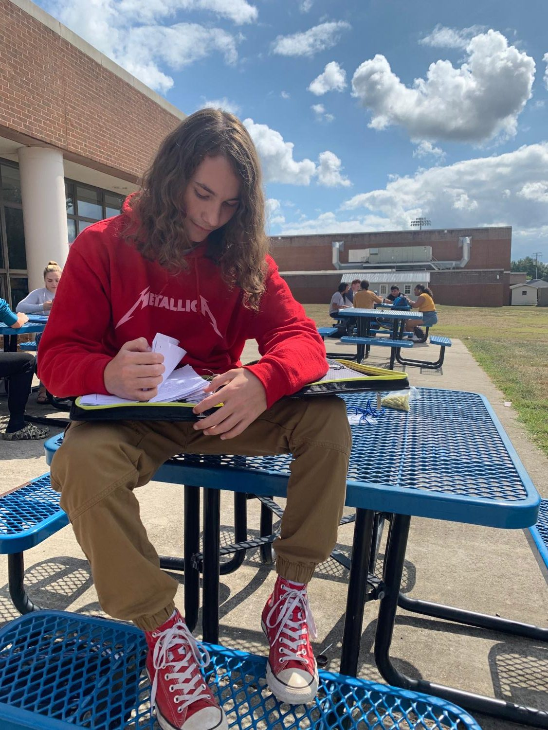 Remington Swisher-Davis looks over some of his favorite songs.
