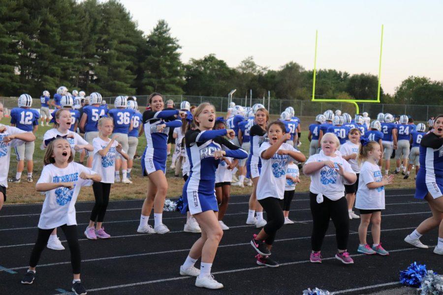 The+little+%27cats+are+cheering+alongside+RCHS+varsity+cheerleaders.