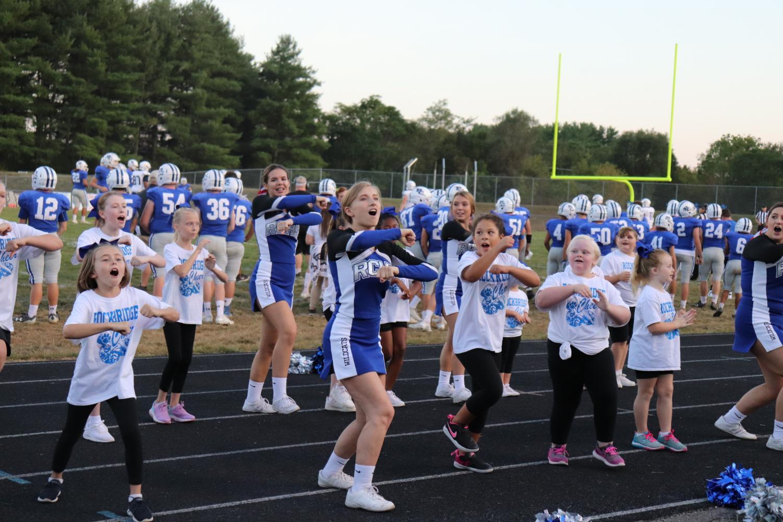 The little 'cats are cheering alongside RCHS varsity cheerleaders.