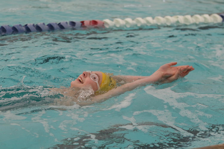 Freshman Ali Pfaff practices her backstroke for the next meet.