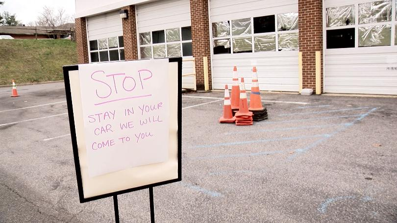 A sign outside the Food Pantry instructs visitors to stay in their cars. Photo provided by WDBJ7.