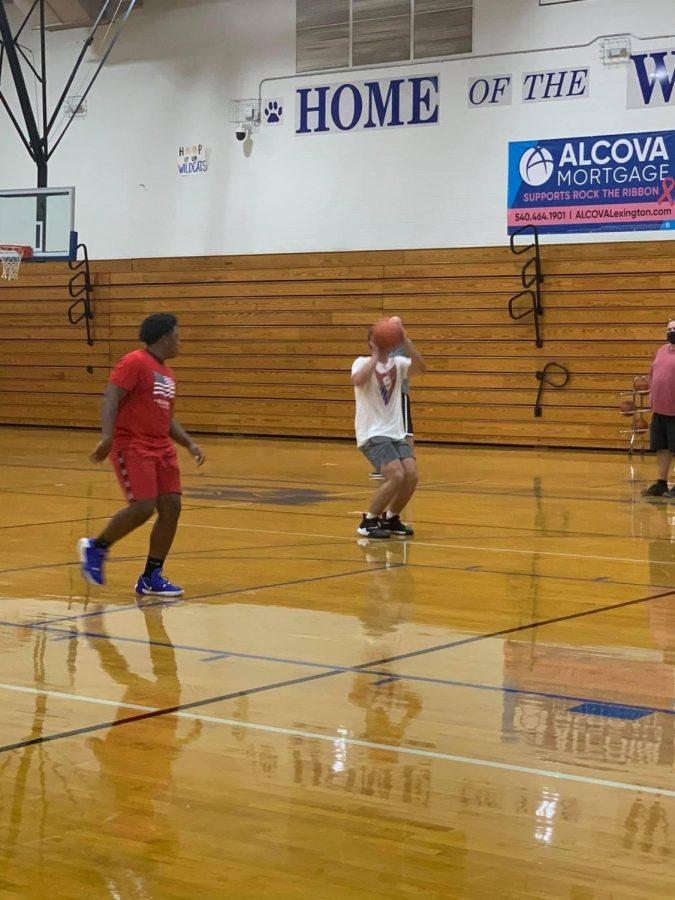 Junior Austin Higgins shooting during a practice
