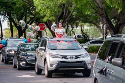Coral Springs, Florida, USA - May 29, 2020: South Florida Graduation Car Parade 2020 during COVID-19 coronavirus quarantine. Florida students celebrating Graduation 2020 at Coral Springs.