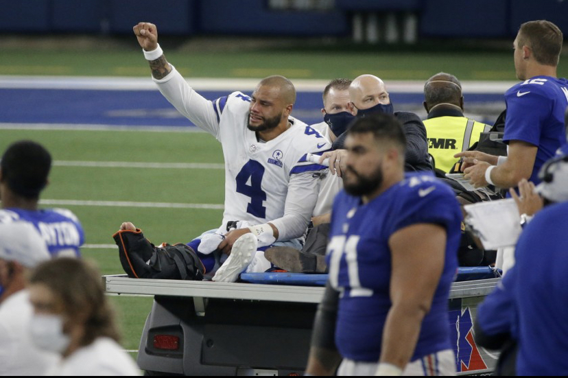 Cowboys QB Dak Prescott being carted off the field after a severe ankle injury.