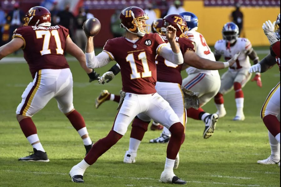 Smith (11) prepares to throw the football in a game versus the Giants.