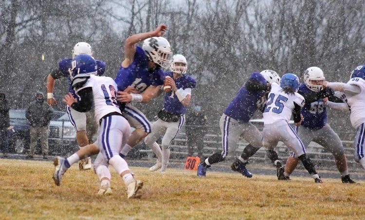 Senior Luke Mayr participates in a practice in the snow.