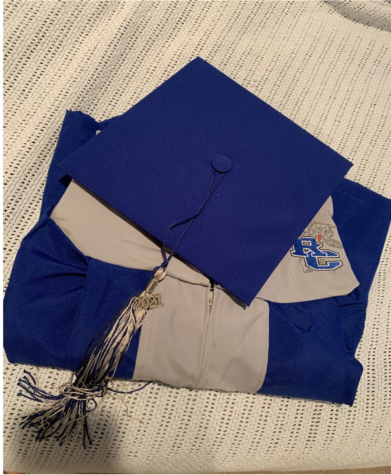 RCHS Seniors pick up cap and gowns on Wednesday, April 14 ahead of the graduation ceremony.
