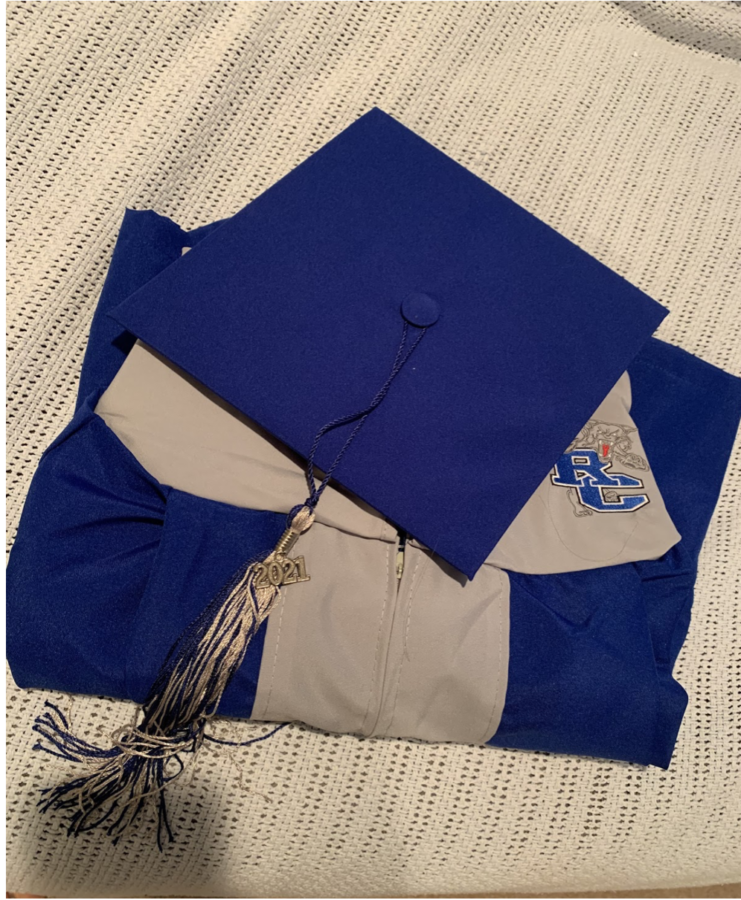 RCHS+Seniors+pick+up+cap+and+gowns+on+Wednesday%2C+April+14+ahead+of+the+graduation+ceremony.