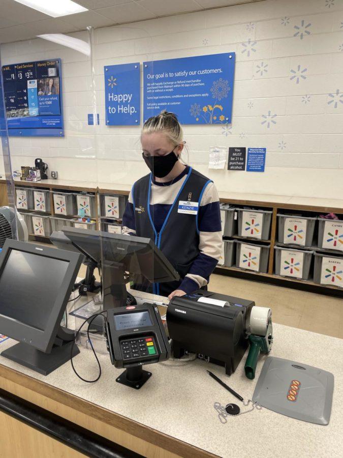 Kenzie Moyers working behind the register at Walmart.