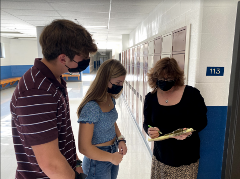 Seamus Looney and Ella Vaught discuss Outreachs plans with Ms. Leadbetter