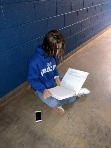 Cross Country runner Megan Timmes does homework after an early morning practice.